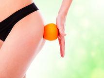 Female backside with an orange Royalty Free Stock Photo