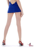 Female backside in short blue dress and high hills Stock Photo
