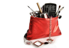 Female bag. With cosmetics and phone isolated on a white background Royalty Free Stock Image