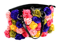 Female bag with artifical flowers Royalty Free Stock Photo