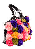 Female bag with artificial flowers Stock Photo