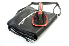 Female bag and hairbrush on a white Stock Photo