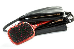 Female bag and hairbrush  on a white Stock Photography