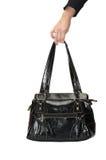Female bag in hand Stock Image
