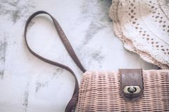 A female bag with a hat on a wooden background stock photo
