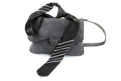 Female bag and man's tie isolated on a white Royalty Free Stock Image