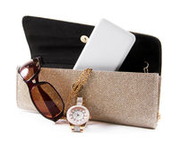 Female bag with phone,sunglasses and watch Royalty Free Stock Photography