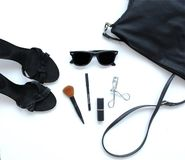 Female bag with cosmetics, sunglasses and shoes Royalty Free Stock Images