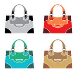 Female bags. A set of female bags of different colors on a white background Royalty Free Stock Photos