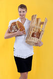 A female baker. A young smiling female baker Stock Photography