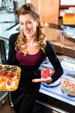 Female baker in confectionery Stock Photos