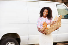 Female Baker Delivering Bread Standing In Front Of Van Stock Photos