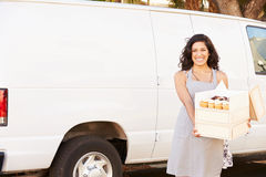Female Baker Delivering Cakes Standing In Front Of Van Royalty Free Stock Photography