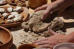 Female baker hands preparing traditional medieval dough for doughnut Royalty Free Stock Photos