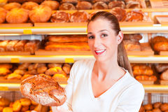 Female baker in her bakery Stock Photo