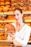 Female baker in her bakery Royalty Free Stock Images
