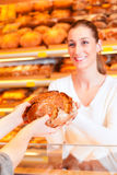 Female baker in her bakery Royalty Free Stock Photography