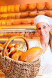Female baker in her bakery Royalty Free Stock Image