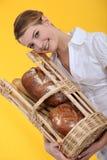 Female baker holding bread Royalty Free Stock Photo
