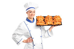 A female baker holding croissants royalty free stock images