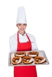 Female Baker Holding Fresh Bavarian Pretzel Royalty Free Stock Photos