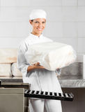 Female Baker Holding Packed Bread Loaf Stock Image