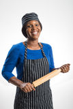 Female baker with rolling pin Royalty Free Stock Photos