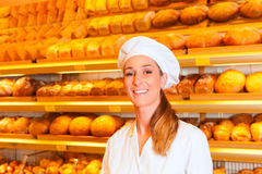 Female baker selling bread in bakery Royalty Free Stock Images
