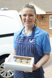Female Baker Standing Next To Van Making Home Delivery Of Cupcak Royalty Free Stock Photography