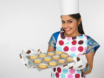 Female Baker With Her Cookies Stock Images