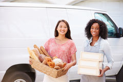 Female Bakers With Bread And Cakes Standing In Front Of Van Royalty Free Stock Images