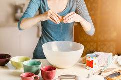 Female baking at the kitchen Stock Images