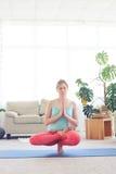 Female balancing in half lotus posture Stock Images
