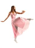 Female ballet dancer. A female ballet dancer in a long, flowing pink dress. White background royalty free stock photo