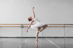 Female ballet dancer keep the rack in class Royalty Free Stock Photo