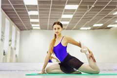 Female ballet dancer in Pointe shoes warming up on the Mat stock images