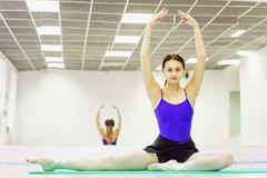 Female ballet dancer in Pointe shoes warming up on the Mat stock photo