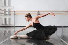 Female ballet dancer posin on rehearsal. Female ballet dancer posing on rehearsal in class. Ballerina dance stock photos