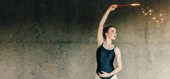 Female ballet dancer practicing dance moves using a firework Royalty Free Stock Image