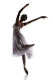 Female ballet dancer. Silhouette of a beautiful female ballet dancer isolated on a white background. Ballerina is wearing a white dress with feathers and pointe stock photography