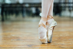 Female ballet dancer standing on toes Royalty Free Stock Images