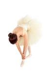 Female ballet dancer streching Stock Images