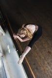 Female ballet dancer stretches stock photo