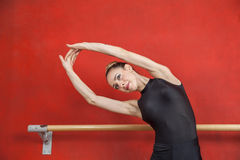 Female Ballet Dancer Stretching With Hands Raised Royalty Free Stock Photography