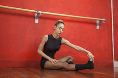 ballet dancer stretching on the floor stock image  image