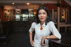 Female bar manager. Portrait of female bar manager standing at the table Royalty Free Stock Image
