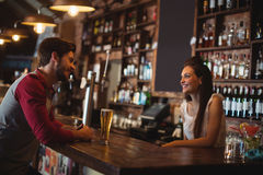 Female bar tender interacting with customer Royalty Free Stock Photo