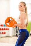 Female with barbell Royalty Free Stock Image