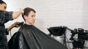 Female barber cutting hair with hair trimmer. Copy space royalty free stock image