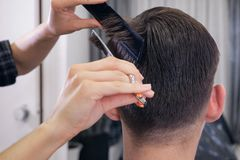 Female barber haircut doing male hair style. Close up royalty free stock images